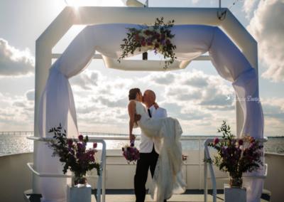 destin wedding flowers ceremony purple kiss