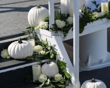 destin wedding flowers white pumpkins sky deck