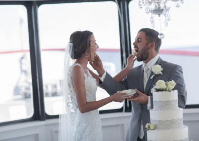 destin wedding reception venue karley feeding cake